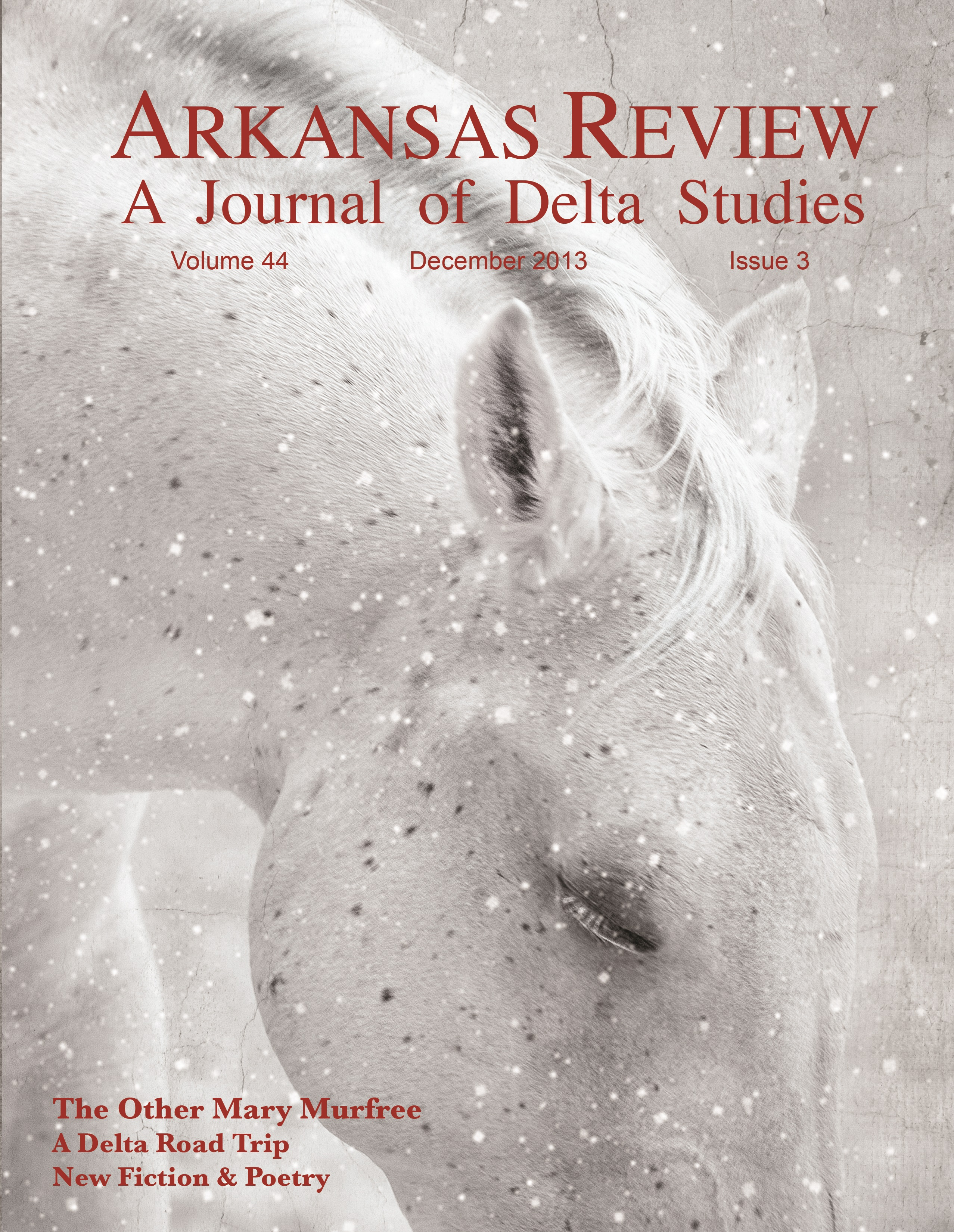 cover image: white horse in snow